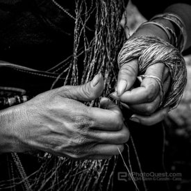 Close Up of Hands Making Hemp Fiber