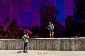Tourists take photographs outside the Museum of Pop Culture in Seattle, Washington.