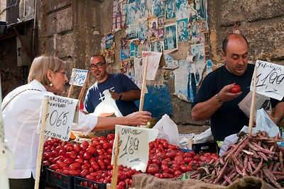 Italy - Palermo - Market traders on their stall in the Capo Market