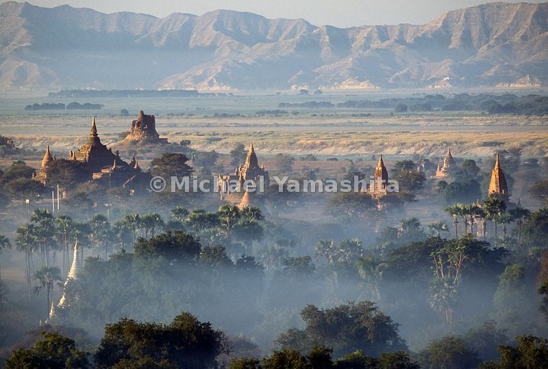 The temples and pagodas of Bagan, Myanmar surrounded by fog.