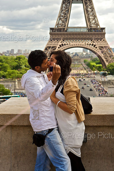 Kissing Couple While Taking a Selfie by the Eiffel Tower