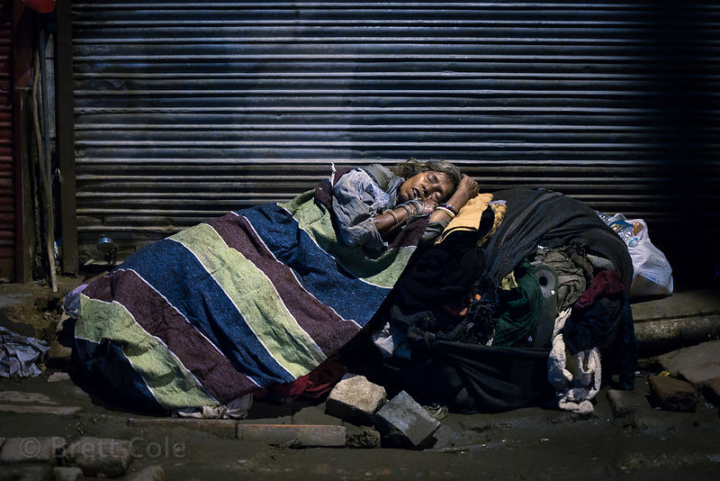 A homeless woman sleeps in the Paharganj  area of Delhi, India. A personal favorite photo. I visited the woman the next morning (this was at 3am) and showed her the photo and gave her some alms. She was tickled.