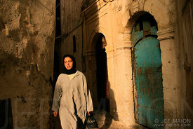 Young woman in a narrow street