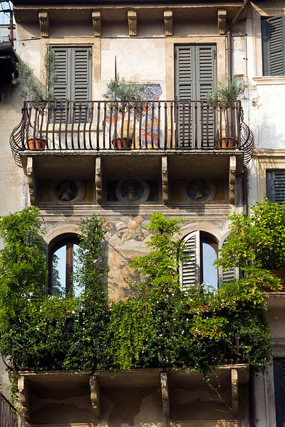 Italy - Verona - A balcony decorated with frescos on a building in the Piazza delle Erbe