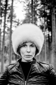 Woman with fur hat in the forest #4