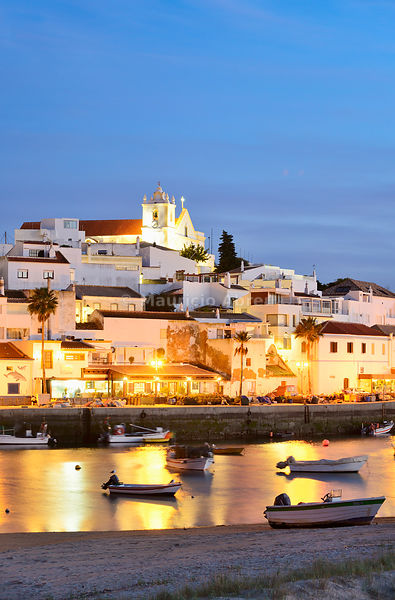 The traditional fishing village of Ferragudo at dusk. Algarve, Portugal
