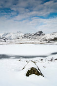 Blea Tarn, between Great Langdale and Little Langdale, frozen in winter. Cumbria, UK