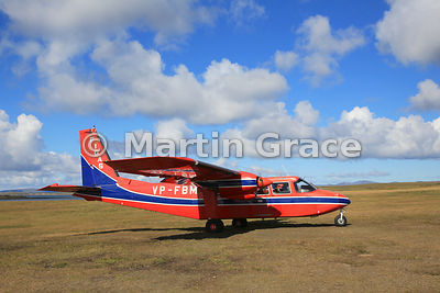 FIGAS (Falkland Islands Government Air Service) Britten-Norman Islander Aircraft VP-FBM on the ground at Saunders Island airstrip, Falkland Islands