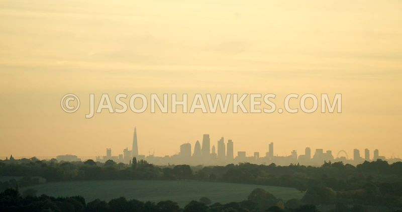 Aerial footage of London skyline. The Shard and City of London, shot from the North East of London.