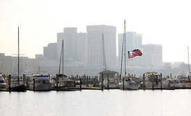 flag_flying_boats_dock_norfolk_skyline_water