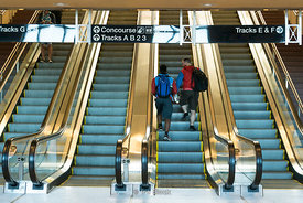 Commuters on the escalator at Frank R Lautenberg Rail Station - Secaucus Junction in New Jersey.