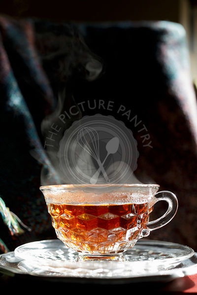 Rooibos tea in a clear cup and saucer