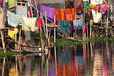 Colorful laundry reflects in the waters of the East Kolkata Wetlands, Kolkata, India.