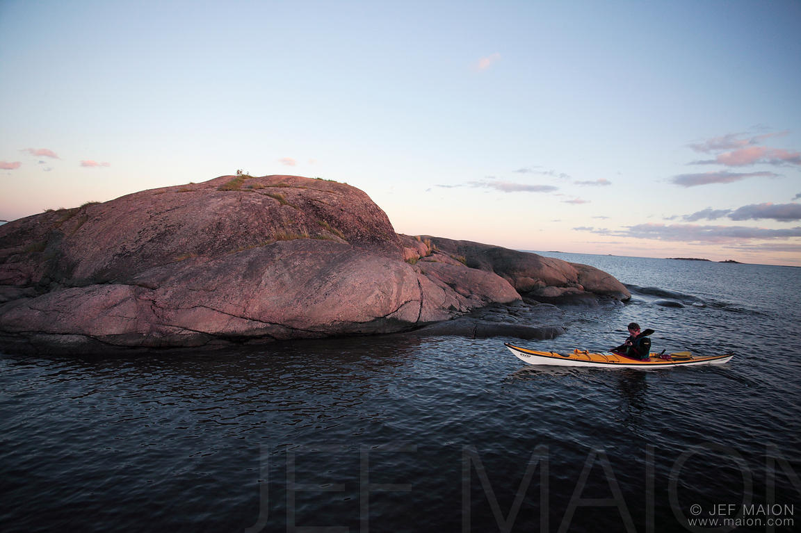 Sea kayak by tiny rock island