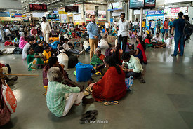 Passengers waiting at the Chhatrapati Shivaji Terminus in Mumbai, India