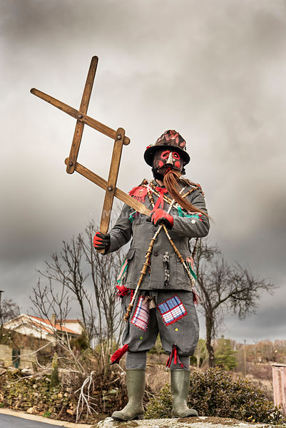 "The ""carocho"", the character thats ""steals"" the sausages of the villagers with the huge tweezers. Traditional Winter festivities in Constantim. Miranda do Douro, Tras-os-Montes. Portugal"