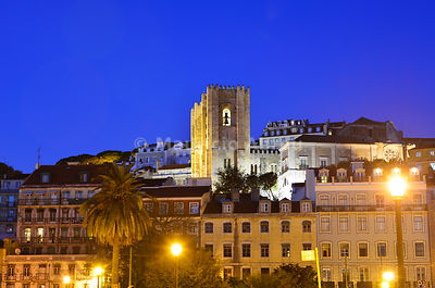 The Sé Catedral (Motherchurch) and the historical centre at dusk. Lisbon, Portugal