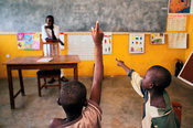 Ghana - Tamale - Street Children raise their hands in class