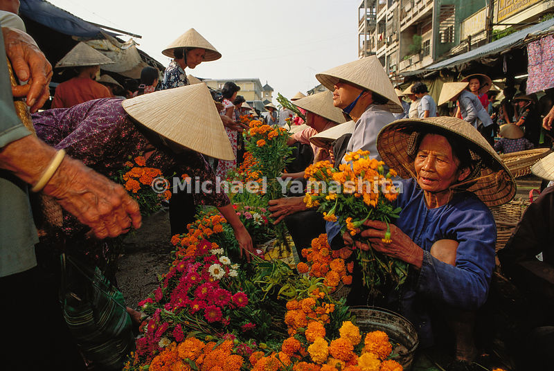 Free enterprise blooms in the Vietnam delta town of Can Tho, where peddlers sell everything from snakes and blue jeans to viivd marigolds.