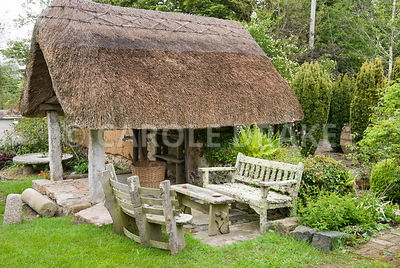 Thatched well house. Caervallack Farm, St Martin, Helston, Cornwall, UK