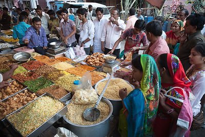 Customers at a popular market stall in Jaipur, Rajasthan, India