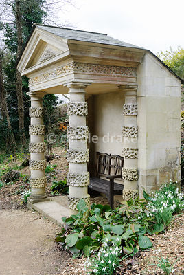 The Doric Seat, originally the porch on the Pigeon House but moved in the Victorian period to replace a rustic feature now lost. Painswick Rococo Garden, Painswick, Glos, UK