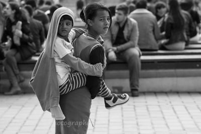 Girl and child piggy-back, Istanbul
