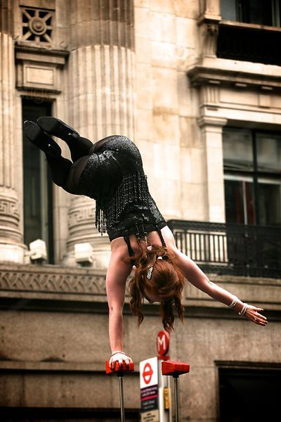 Hand Balancing Circus Performer on Stage in Regent Street