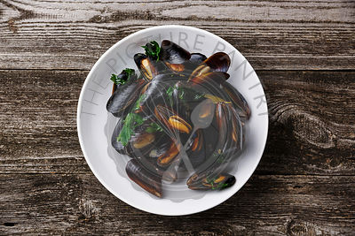 Mussels Clams on wooden background