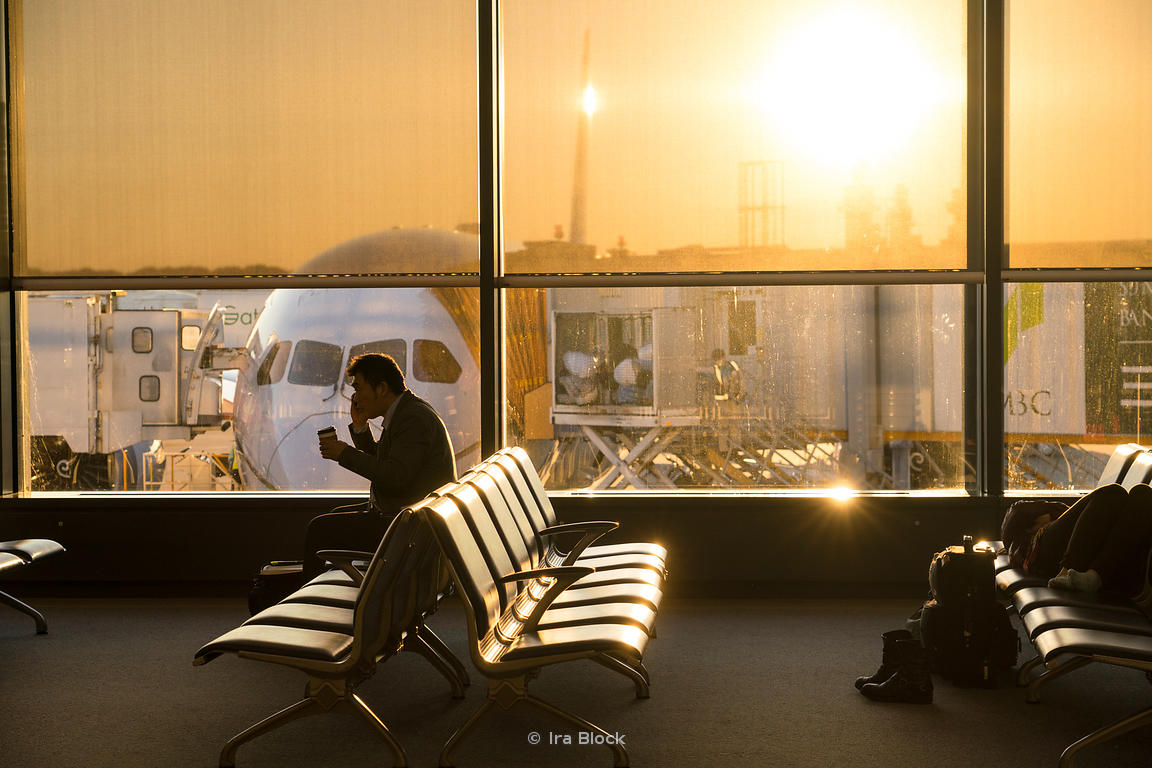Sun sets over the Tokyo international airport in Tokyo, Japan.