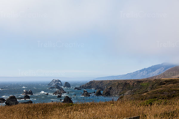 A beautiful view of craggy rocks and deep blue waters of the Northern California coast.