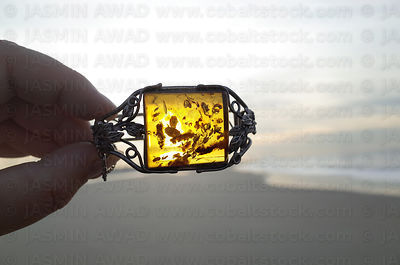 Vintage silver bracelet with amber gemstone in the evening sun