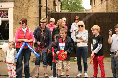Family Laughing at Olympic Torch Relay in Chipping Campden