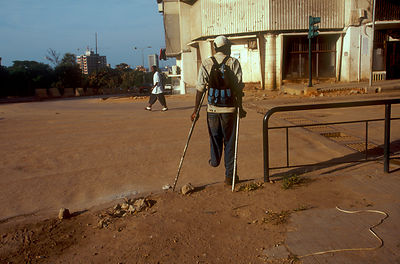 Angola - Luanda - A disabled man begs on the street