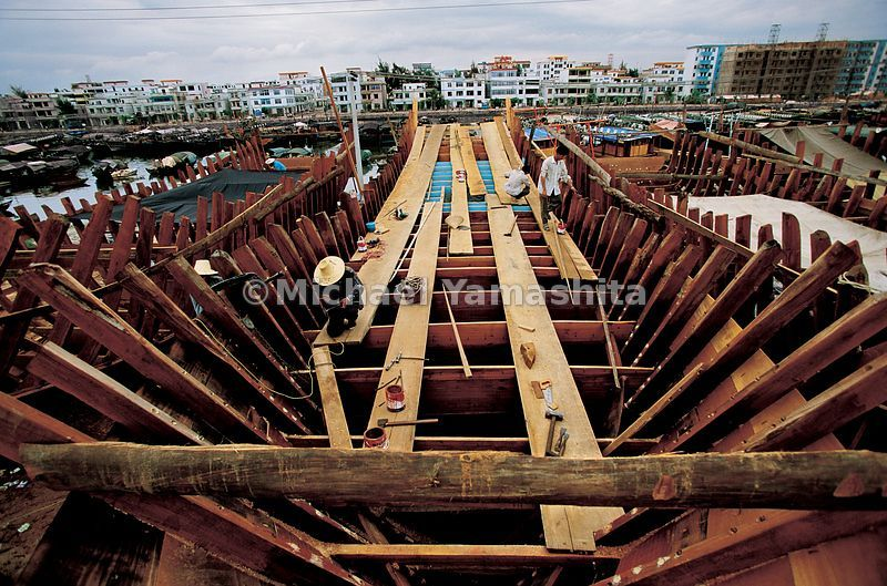 These are the last of the wooden junks on Hainan Island, as China banned the use of wood as a building material for fishing boats in 2001. Zheng He sailed on ships eight times the size of this one. .