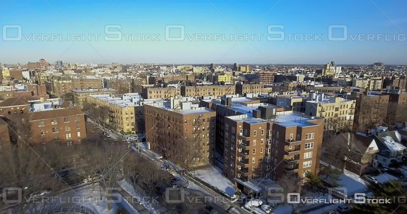 Aerial Over Snow Covered Rooftops Buildings Streets Winter Day Brooklyn NYC