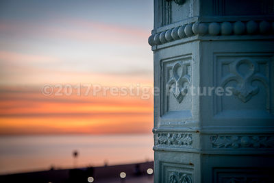 Detail of Wrought Iron Lampost against a Sunset in Brighton