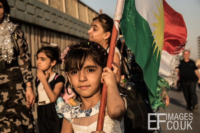 A little girl carries the Kurdish flag outside the Franso Hariri Stadium in Erbil shortly before the last rally of the Kurdish Independence Referendum Campaign. 22/09/2017 Elizabeth Fitt