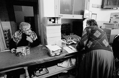 UK - London - An old woman collects her grocery allowance from the Soup Kitchen
