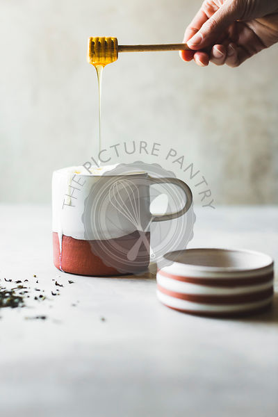 Honet tea latte with handmade ceramic mug and dish