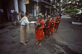 Novice monks receiving alms