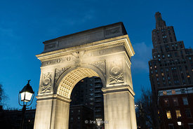A view of the arch at Washington Square Park in New York City at twilight.