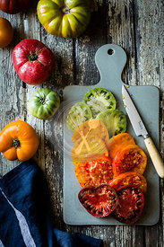 Colourful heirloom tomatoes on a chopping board