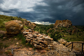 Remains of a wall and a pile of rocks that was used to defend the route to the summit of Mapungubwe Hill.
