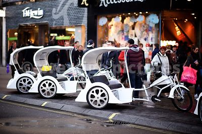 Line of White London Rickshaws Waiting for Customers