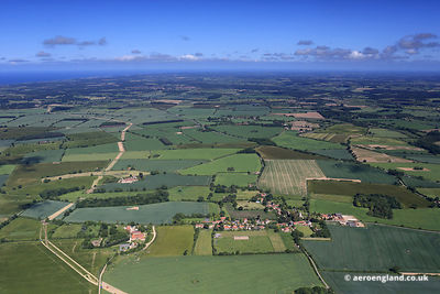 aerial photograph of the Norfolk Countryside with the village of Bale in the foreground
