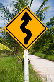 Thailand Asia - A road bends warning sign.