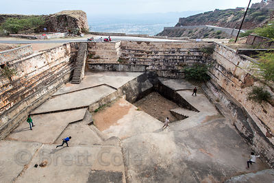 Boys play cricket in an abandoned stepwell at Taragarh Fort, high above Ajmer, Rajasthan, India