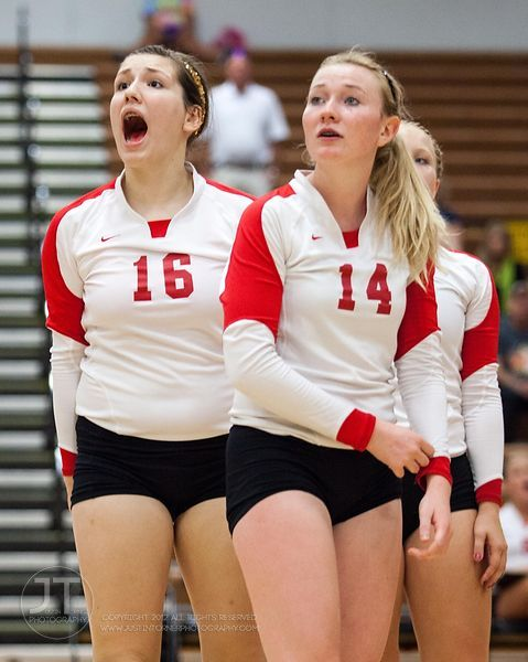 Marion players Alyssa Thomas (16) and Johanna Steggall (14) react to an official's call  at the 2012 Linn-Mar Varsity Volleyball Tourney Saturday, September 8, 2012. (Justin Torner/Freelance)