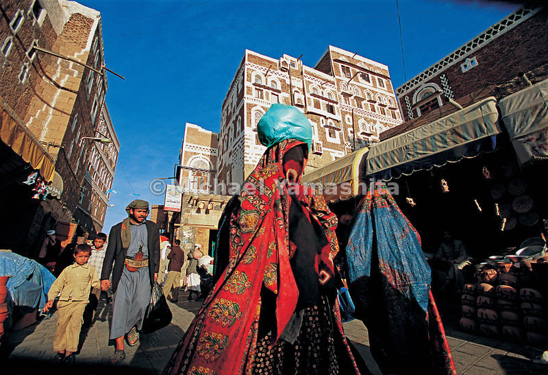 Though many women in Yemen shroud themselves completely in black , colorful head scarves and veils (hejab) are often seen in the markets.